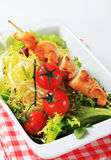Chicken skewers and salad greens Stock Photo