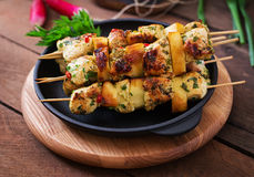 Chicken skewers. With slices of apples and chili stock photo