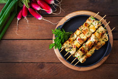 Chicken skewers. With slices of apples and chili. Top view stock photos