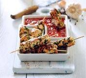 Chicken skewers in spicy marinade and tomato dip. royalty free stock photo