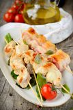 Chicken skewers. With vegetables on wooden table Royalty Free Stock Image