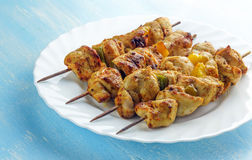 Chicken on skewers. Chicken skewers on a white plate stock photos