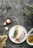 Chicken small breasts with sage leaves, floral honey, salt, olive oil, garlic, with thin strips of bacon before baking Stock Photography