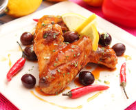 Chicken. Some chicken with a sauce of chili and olives stock images