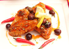 Chicken. Some chicken with a sauce of chili and olives royalty free stock images