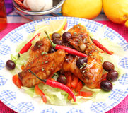 Chicken. Some chicken with a sauce of chili and olives stock photography