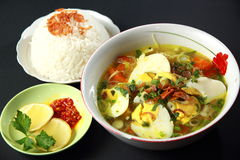 Chicken Soto. Indonesian chicken soto or soto ayam, served with white rice, and chili sauce Royalty Free Stock Photos