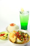 Chicken Soto. Indonesian chicken soto or soto ayam, served with white rice, chili sauce and a glass of lemonade Royalty Free Stock Images