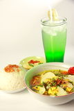 Chicken Soto. Indonesian chicken soto or soto ayam, served with white rice, chili sauce and a glass of lemonade Stock Image