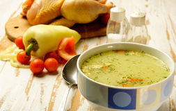 Chicken soup. In a bowl with fresh ingredients and herbs Stock Image