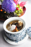 Chicken soup. With spiral shells. table decoration in the background Royalty Free Stock Photos