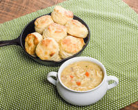 Chicken soup with baked biscuits Stock Photography