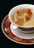 Chicken soup with beans and vegetable. Served on traditional Chinese decorative bowl and saucer Stock Photo