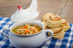 Chicken soup and biscuits on table Royalty Free Stock Image