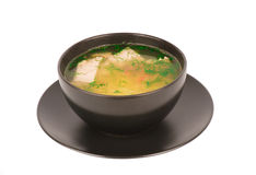 Chicken soup in the black bowl isolated. Royalty Free Stock Image