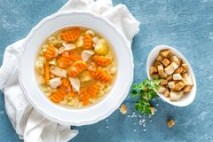 Chicken soup, bouillon with meat, pasta and vegetables Stock Image