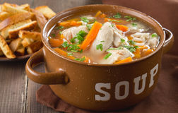Chicken soup. In a bowl with crackers Stock Photo