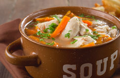 Chicken soup. In a bowl with crackers Royalty Free Stock Photos