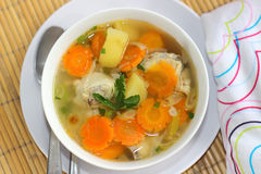 Chicken Soup. A bowl of Chicken Soup served with slices of potato and carrots Royalty Free Stock Photo