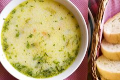 Chicken soup and bread Stock Photo