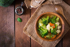Chicken soup with broccoli, green peas, carrots and celery Stock Image