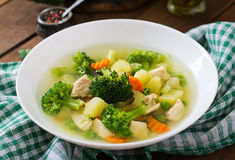Chicken soup with broccoli, green peas, carrots and celery Royalty Free Stock Photos