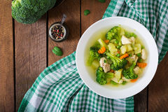 Chicken soup with broccoli, green peas, carrots and celery Stock Photos
