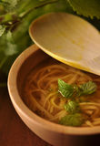Chicken soup - broth. In wooden bowl Stock Image