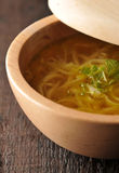Chicken soup - broth. In wooden bowl Stock Photography