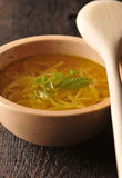 Chicken soup - broth. In wooden bowl Royalty Free Stock Image