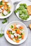 Chicken soup with carrot, broccoli, potato, top view Royalty Free Stock Photography