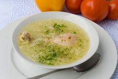 Chicken soup with chicken leg Stock Image