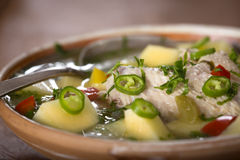 Chicken soup. Close up of some Bowl of chicken soup with vegetables and hot chili pepper royalty free stock images