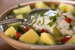 Chicken soup. Close up of some Bowl of chicken soup with vegetables and spoon Stock Photography