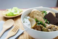 Chicken soup cooking with Thai herb ready to serve. Thai food royalty free stock photos