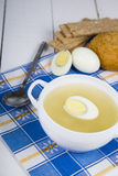 Chicken soup with egg Royalty Free Stock Image