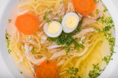 Chicken soup with eggs Royalty Free Stock Image