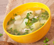 Chicken soup with green peas Royalty Free Stock Photos