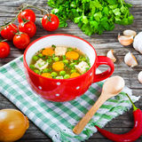 Chicken soup with green peas and carrot, top view Stock Images