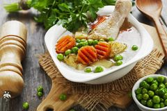 Chicken soup with green peas royalty free stock photography