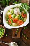 Chicken soup with green peas Stock Photos