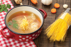 Chicken soup. Homemade chicken soup with carrot, parsley and cauliflower Stock Image