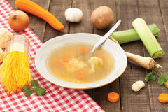 Chicken soup. Hot healthy vegetable soup with carrot, parsley and cauliflower Stock Photos