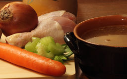 Chicken soup and ingredients Royalty Free Stock Photography