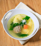 Chicken soup with meatball and tortellini Royalty Free Stock Photos