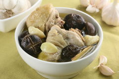 Chicken soup with mushroom and garlic in white bowl Stock Photos