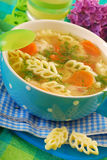 Chicken soup with noodle for child Stock Images