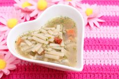 Chicken soup with noodles Stock Images