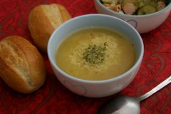 Chicken soup with noodles. A fresh chicken soup with noodles and some bread Royalty Free Stock Photography