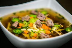 Chicken soup with noodles and fresh vegetables in bowl Stock Photos